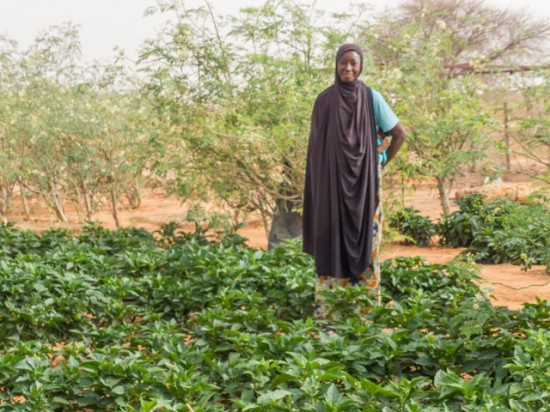 Gonzare woman proudly shows off  her crops – Photo courtesy of our partner Eliminate Poverty Now