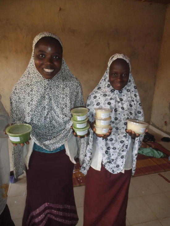 Photo of the girls holding up their Moringa creams