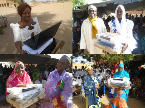 Photo of 2015 graduates, receiving their laptops